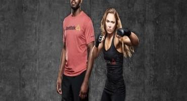 I campioni UFC di Arti Marziali Miste Ronda Rousey e Jon Jones firmano con Reebok