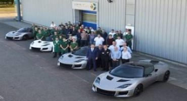 The first Lotus Evora 400 sports cars leave Lotus' Hethel headquarters, on the way to dealerships